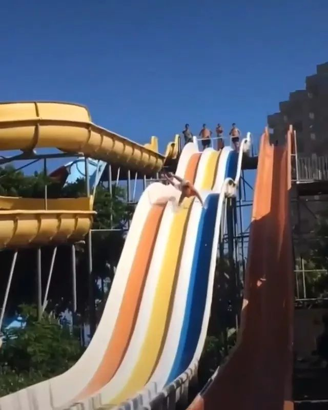 Lucky man slipping water in water park - Video & GIFs | man, performance, water slide, false, lost, swimming pool, water park, Australia travel