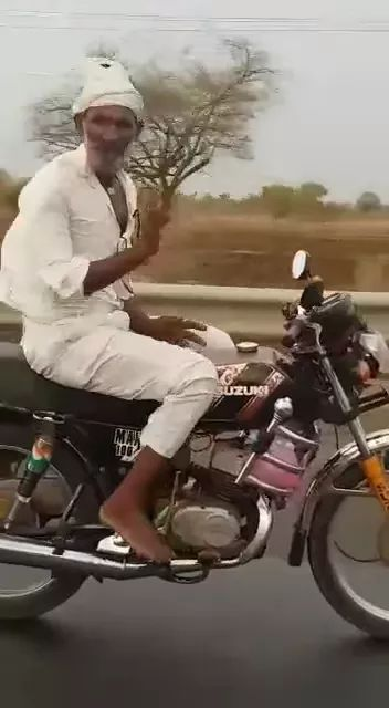 Granddad performed on a sports motorcycle on the street