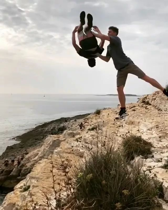 Man performing jumping from cliffs to sea - Video & GIFs   men, male fashion, sports shoes, performances, dancing, acrobatics, cliffs, sea