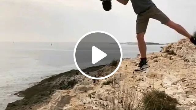 Man Performing Jumping From Cliffs To Sea - Video & GIFs | men, male fashion, sports shoes, performances, dancing, acrobatics, cliffs, sea