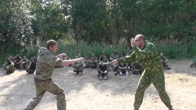 In army, two soldiers are being trained in martial arts