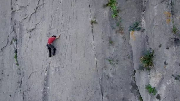 Talented man performing climbing cliff