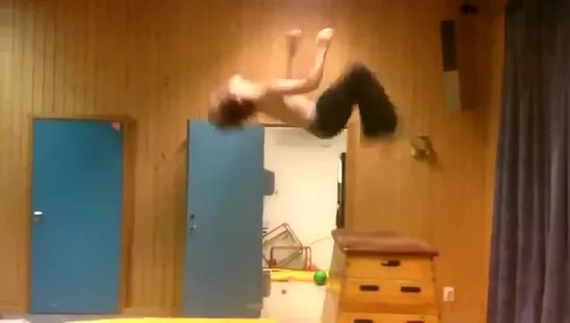 Man practicing acrobatics in gym