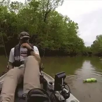 a man fishing on the river and saw crocodile