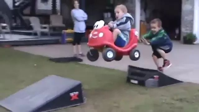 Baby driving toy car overcomes obstacles