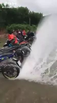 rear wheels of motorcycles touch water and push water up high