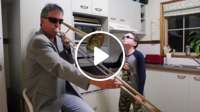 Father and son are performing music in kitchen, musical instruments, performances, kitchens, luxurious furniture