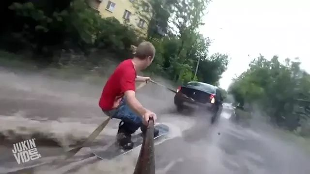 Man surfing on the road