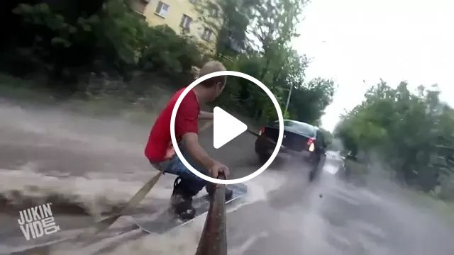 Man surfing on the road, man, surfing, flooded roads, rain, luxury vehicle, phone, camera