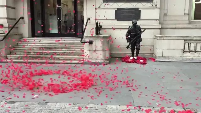 In street, petals fly high according to wind. - Video & GIFs | on the street, the petals, fly, high, follow the wind, Europe travel, romance