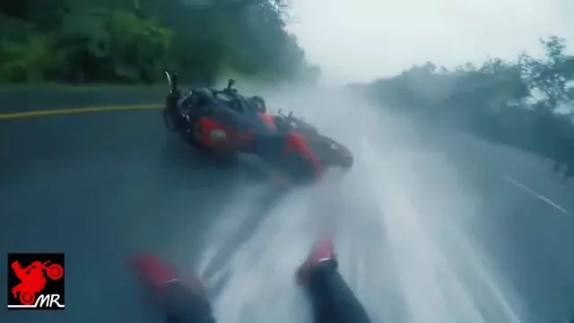 sports motorcycle and man slipping on the street
