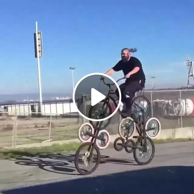 Man driving bike with many wheels