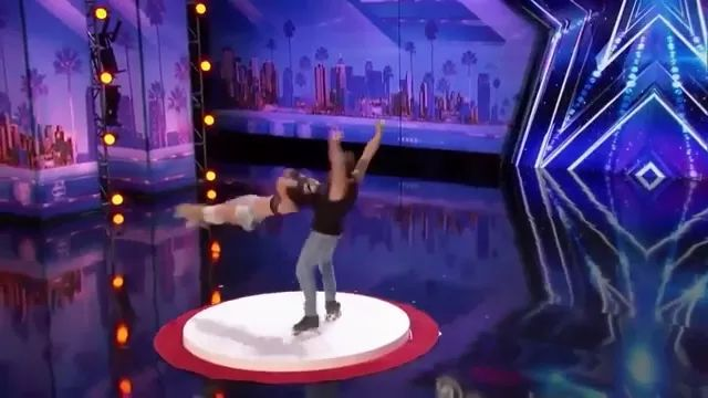 a man performs roller skating and has a strong beard