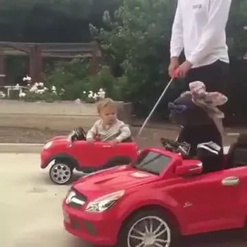 Dog and baby on luxury toy cars