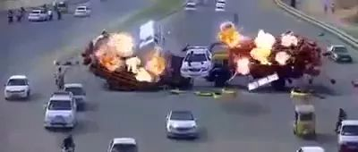A lot of fires on the road, police cars crossed trucks