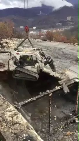 Demolitition machines, building is destroyed very safely