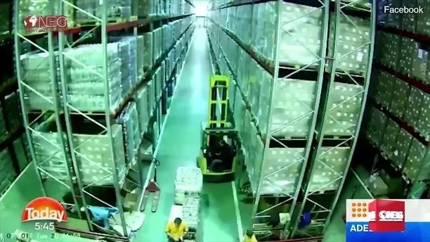 In warehouse, forklift man bumped into shelf