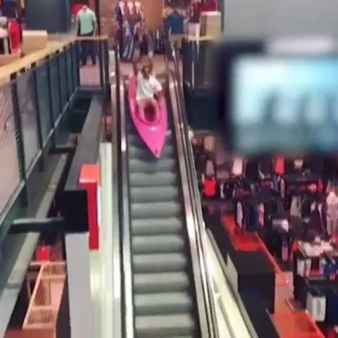 a man went down escalator in commercial center