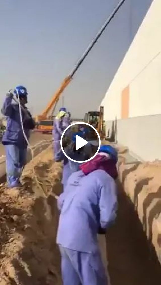 Smart Workers In Digging Soil - Video & GIFs | workers, protective clothing, safety shoes, safety helmets, smart, digging soil