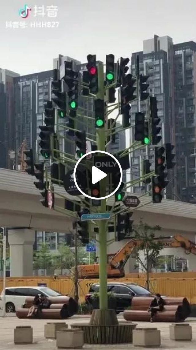 On The Street, There Are Many Traffic Lights - Video & GIFs   on the street, traffic lights, apartment buildings, bulldozers, works, luxury cars, sewers, motorcycles, helmets, luxury vehicles