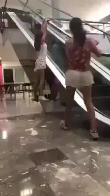 In supermarket, girls performed on the elevator
