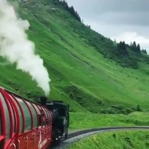 Travel by train across mountain is very interesting