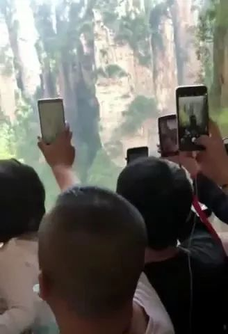 Tourists in elevator to go up mountain