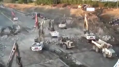 In street, excavators and construction machines destroyed bridge in a very short time