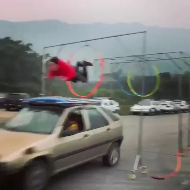 a man flew on the roof of car