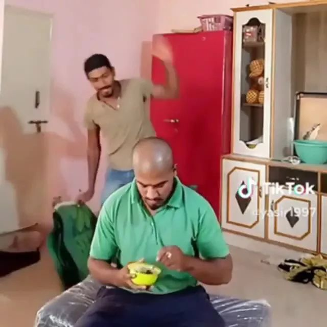 a man is eating food in living room - Video & GIFs | Cute men, fashionable clothes, good food, living room equipment, luxurious furniture