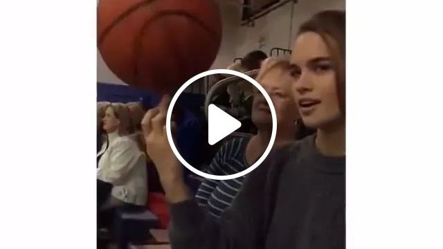 While watching basketball, girl turned basketball ball on her finger, basketball, girls, fashionable clothes, spinning basketball, on fingers