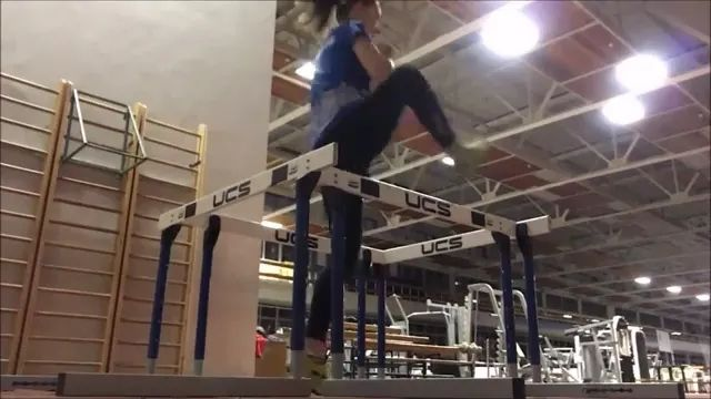 In gym, girl practices walking through obstacles