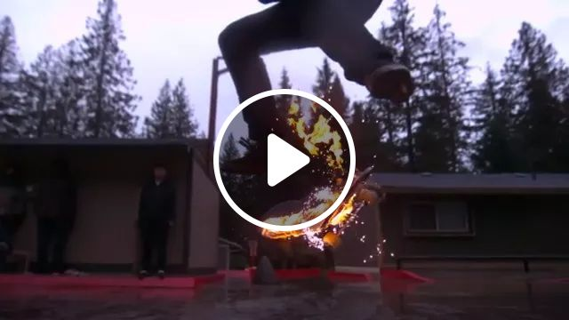 Man skateboarding with fire