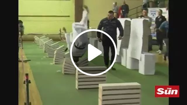 Teen Taekwondo Champion breaks 111 Concrete Blocks in 35 Seconds, Brave man, sports clothes, martial arts performances