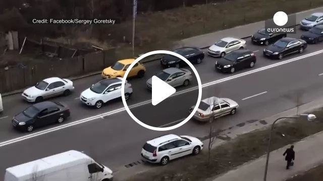 Car running backwards on the road