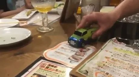 car transforms, Toy car, wooden table, glass cup