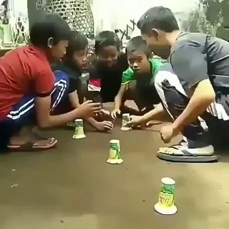 kids quickly took toys from plastic cups