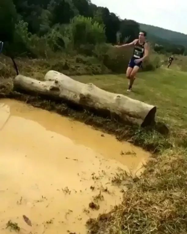 Athletes cross a large puddle