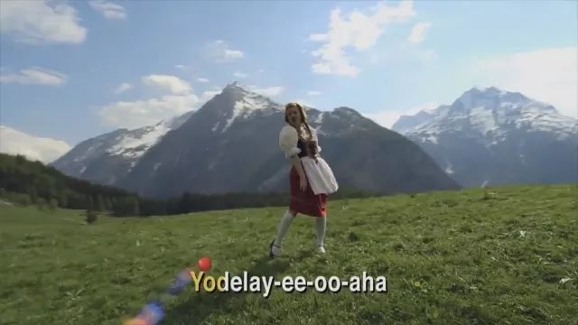 Beautiful girl singing in mountain